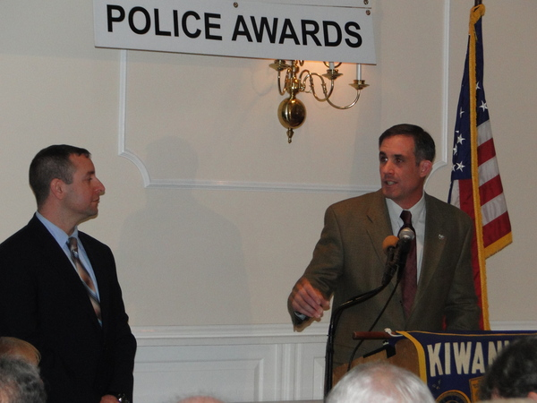 East Hampton Town Police Captain Michael Sarlo presents Police Officer David E. Martin with their department's police officer of the year honors Friday night.