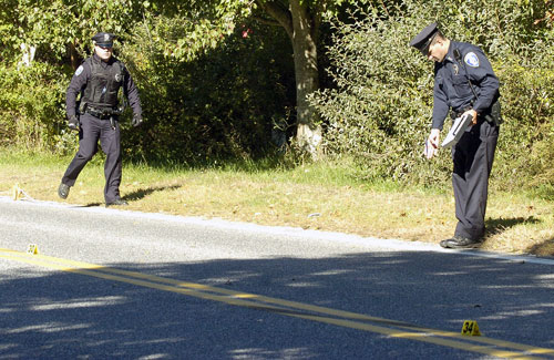 Police investigate the scene of a fatal accident on Mitchells Lane in Bridgehampton on Monday morning.