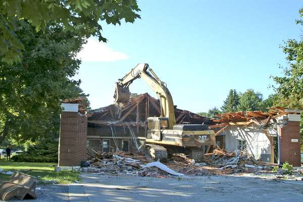The Hampton Road firehouse being demolished Thursday morning.<br></noscript>Photo by Kim Covell