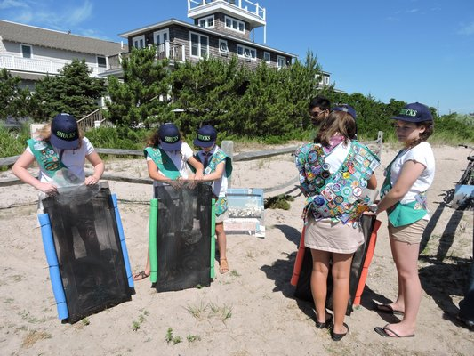 Volunteers helped assemble 10 oyster cages