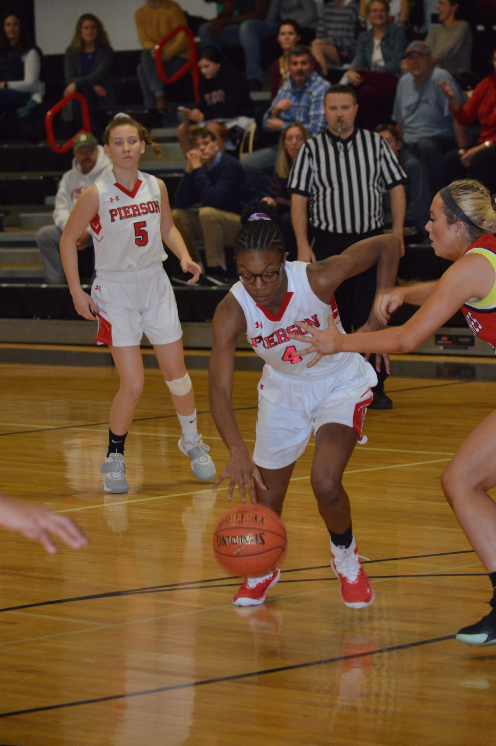 Pierson's Gylia Dryden drives to the basket against Center Moriches.