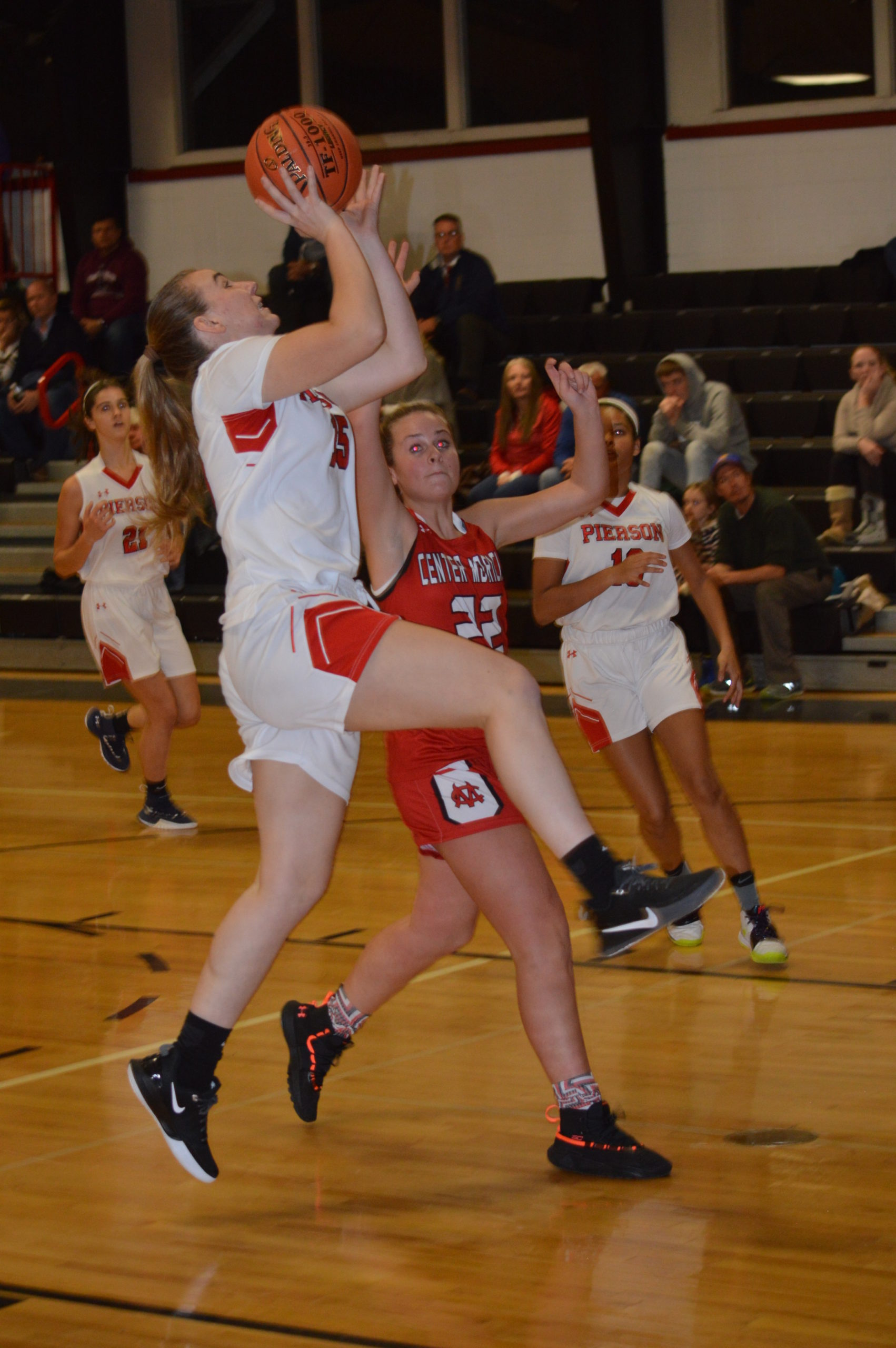 Kathryn Powell shooting against Center Moriches.