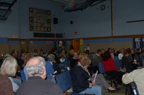Remsenburg resident Morgan Richardson stood to ask a question at the Remsenburg Association's Deer Management Informational meeting on Sunday. Alexa Gorman
