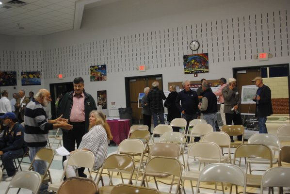 Attendees mingle at the last informational meeting about