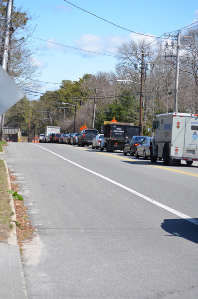 A line of cars traveling eastbound on Montauk Highway wait in traffic due to the Long Island Rail Road bridge construction project. ERIN MCKINLEY