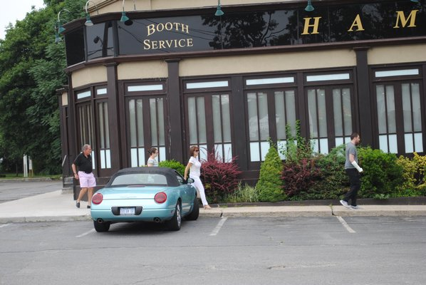 Disappointed customers walk away from Hampton Bays Diner at lunchtime after approaching the establishment's locked doors. AMANDA BERNOCCO