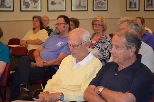 reads a letter sent to him by Hampton Bays Library Director Susan LaVista