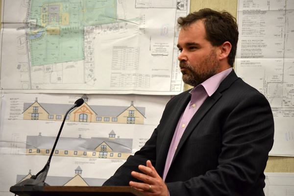 Resident Fred Meyer discusses the Remsenburg Estates proposal at last week's Planning Board meeting. ERIN MCKINLEY