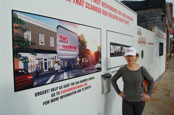 April Gornik of the Sag Harbor Partnership outside the site of the Sag Harbor Cinema. JON WINKLER