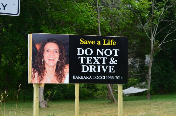This new sign erected on Flanders Road reminds drivers of the consequences of texting and driving. Alexa Gorman