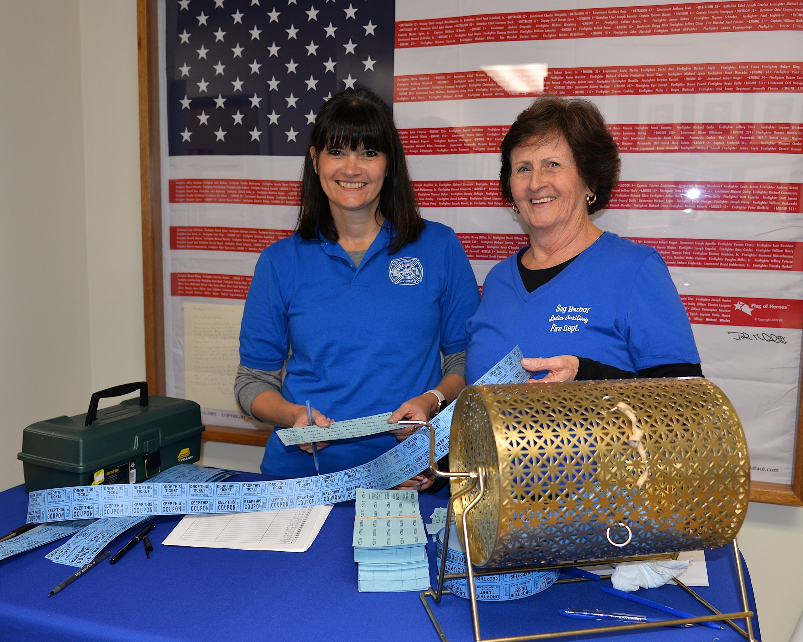 The Ladies Auxilliary of the Sag Harbor Fire Department hosted a holiday sale on Friday. Jody Miller and Betsy Remkus of the Ladies Auxilliary were in charge of the raffle table. KYRIL BROMLEY