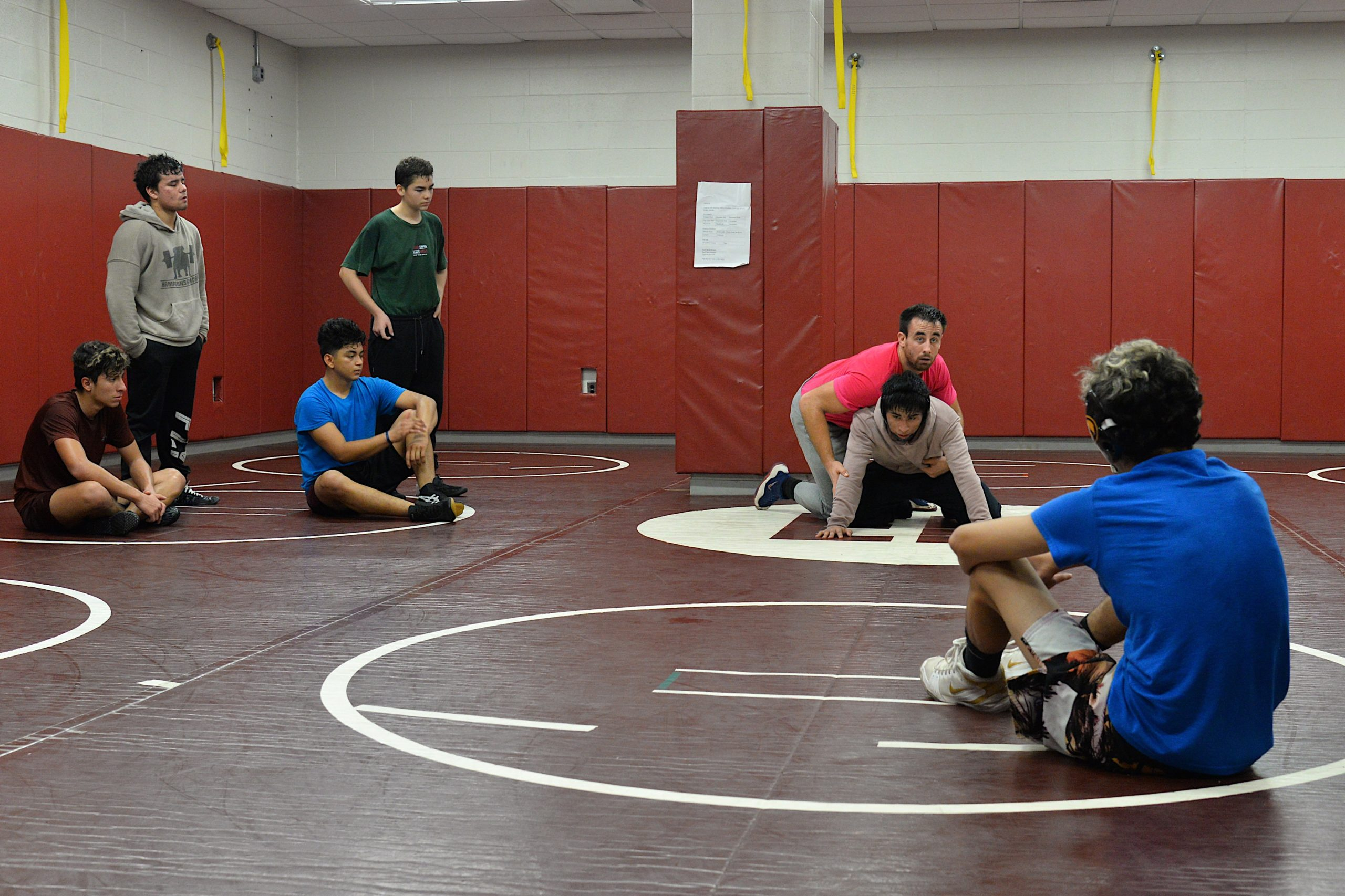 New coach Ethan Mitchell demostrates for his wrestlers.