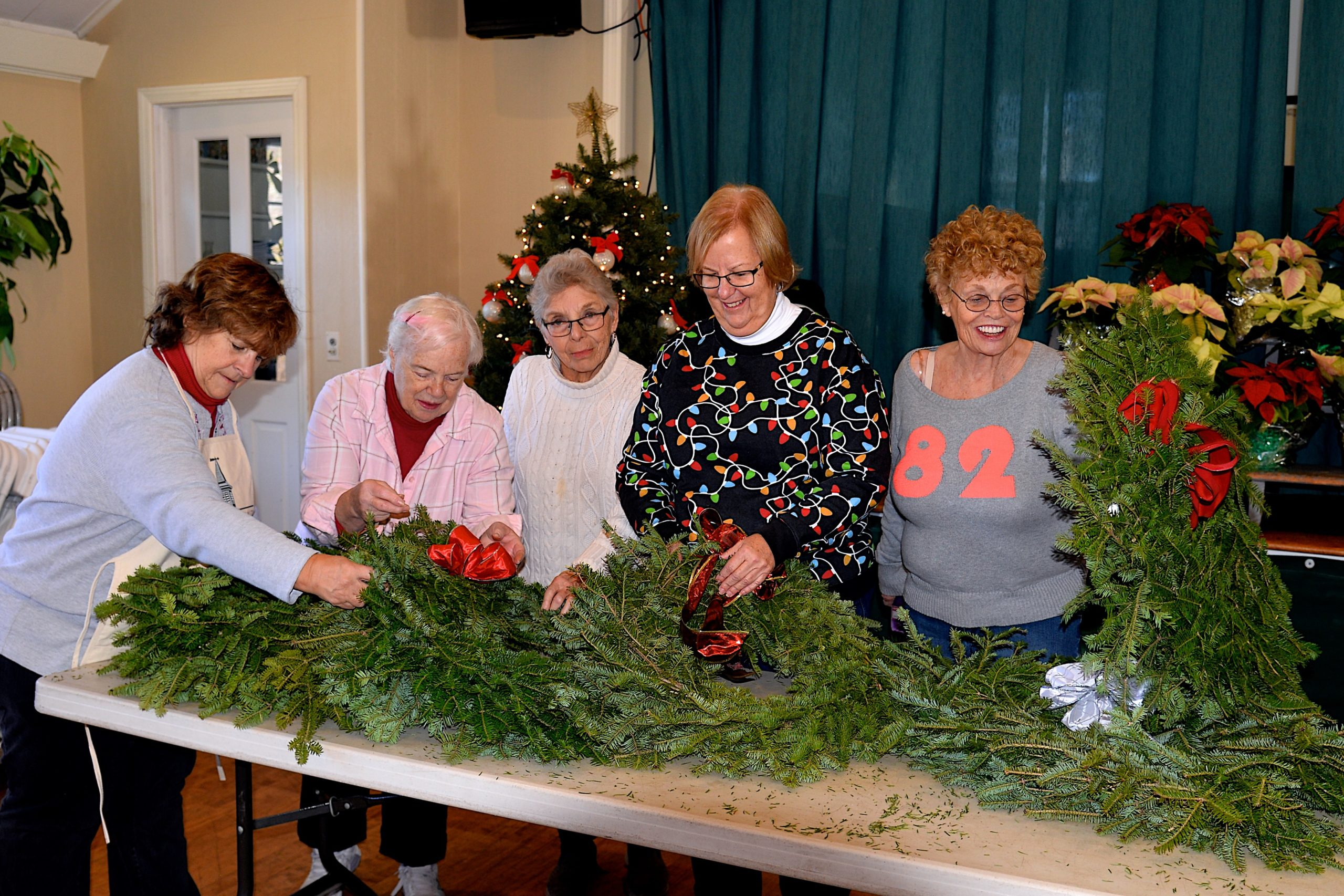 Wreaths were made and quickly sold at the Springs Community Presbyterian Churchon  Saturday. From left, Wendy Hall, Deanna Tikkanen, Dru Raley, Pastor Linda Maconochie and Pat Titus were there to help out. KYRIL BROMLEY
