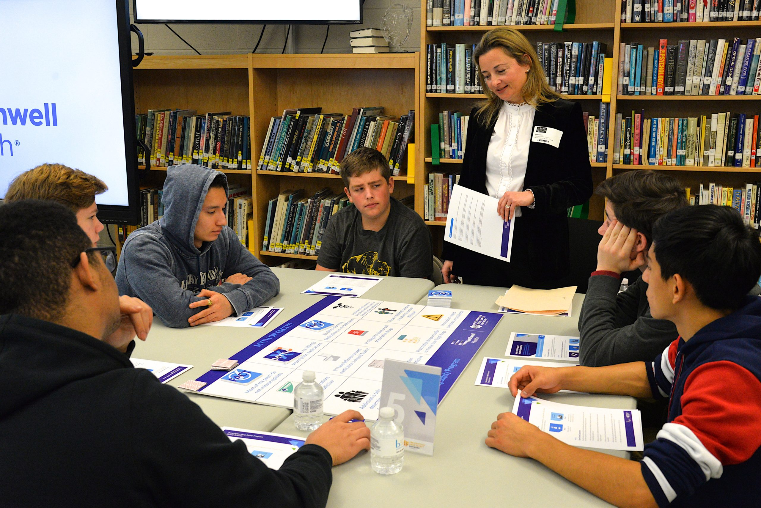 Sabina Zak speaks with students at one table. KYRIL BROMLEY