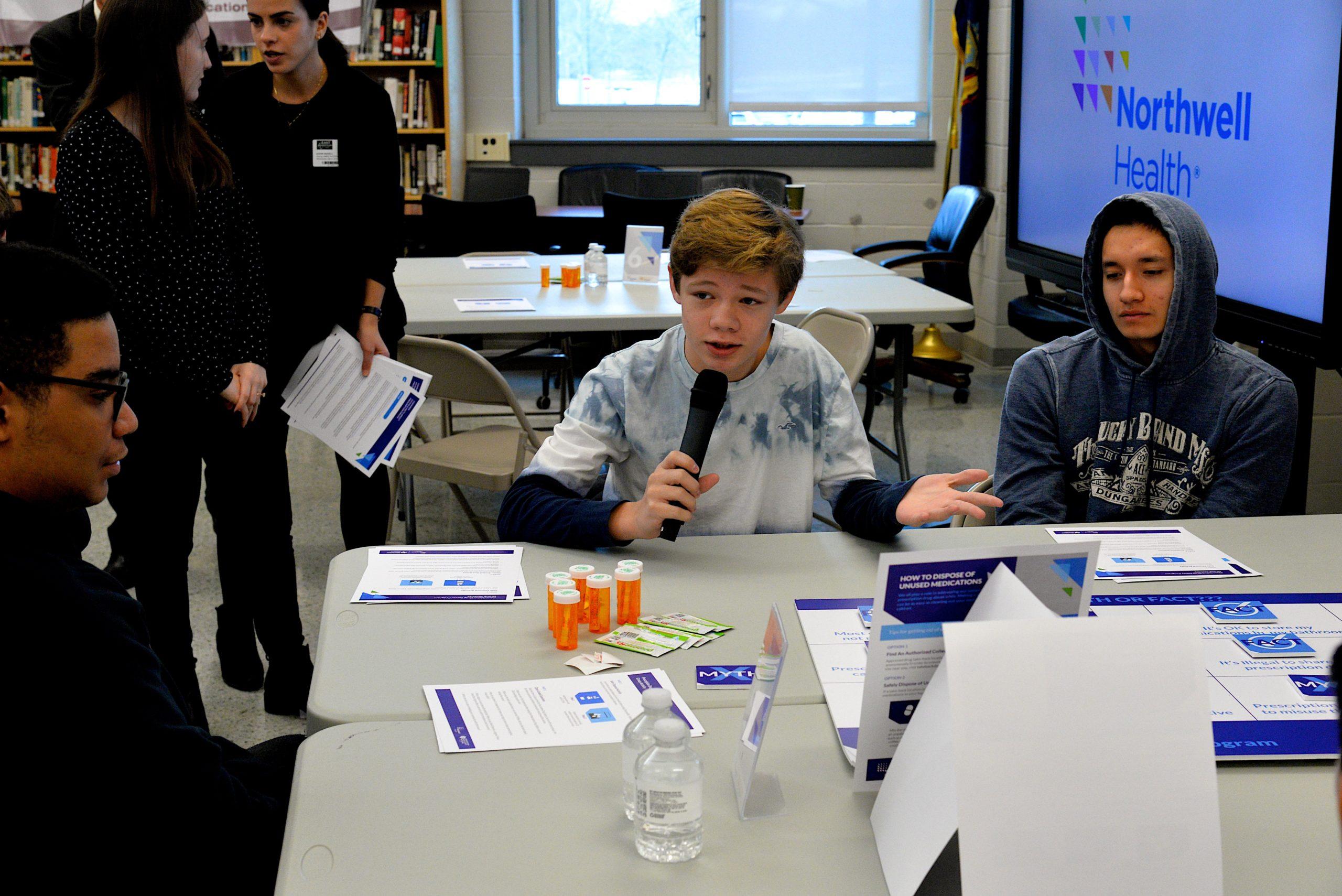 Jason McKenna, a ninth-grader,  speaks at one table.    KYRIL BROMLEY
