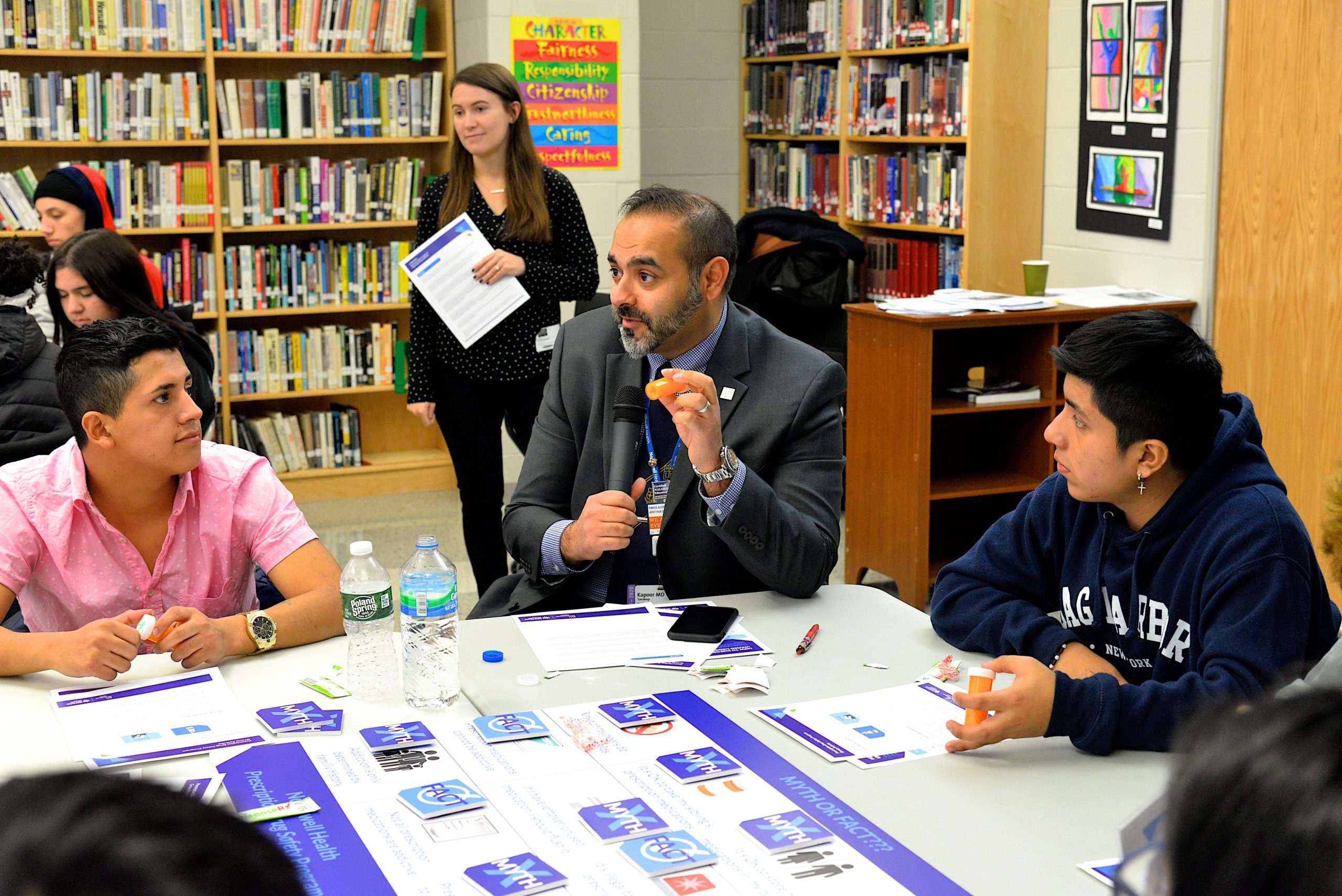 Sandeep Kappor, MD, leads students at one table in a discussion of prescription drug