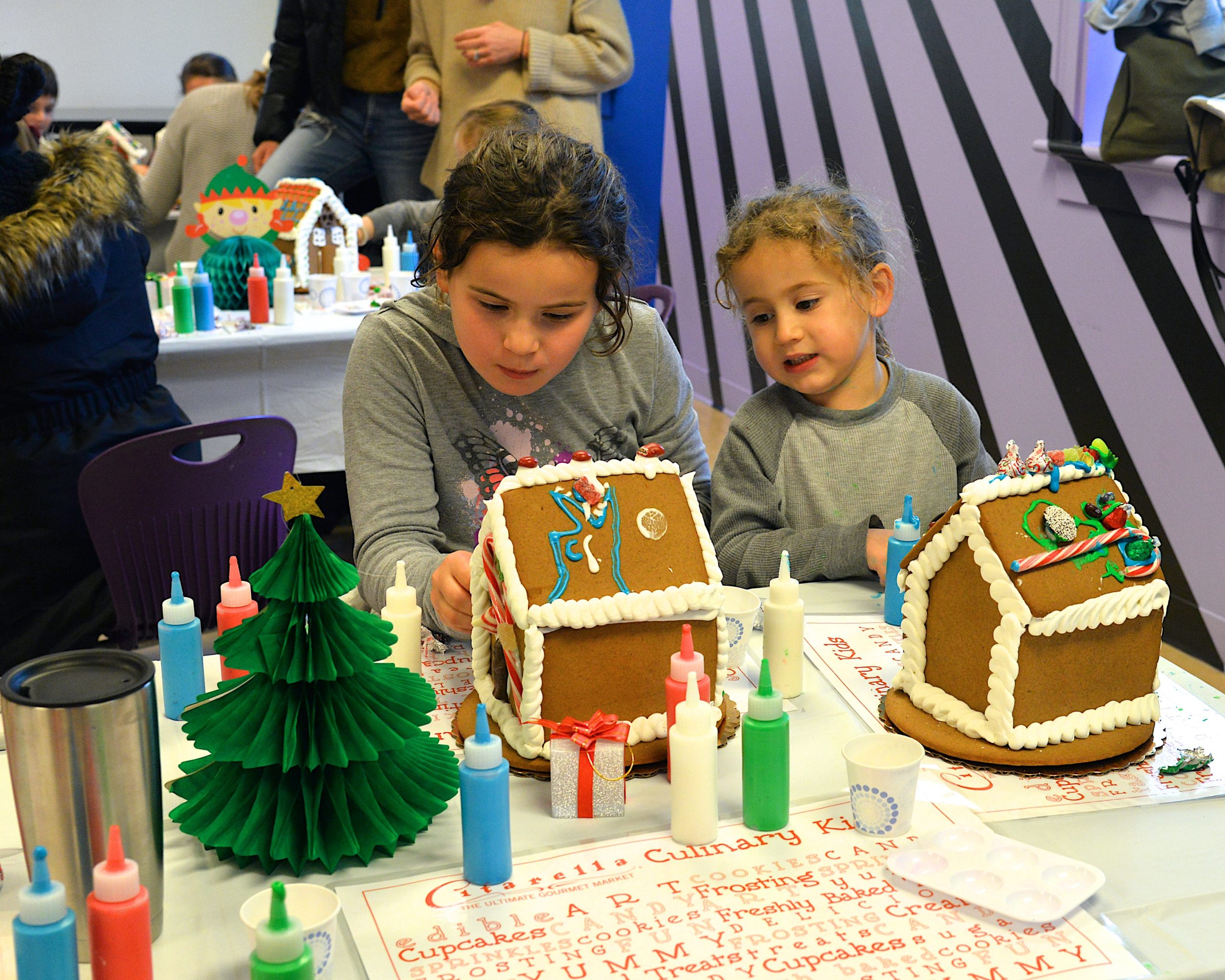Guild Hall offered an opportunity to get in the holiday spirit by making gingerbread houses on Saturday. Wesley and Louie Bull intent on their work. KYRIL BROMLEY
