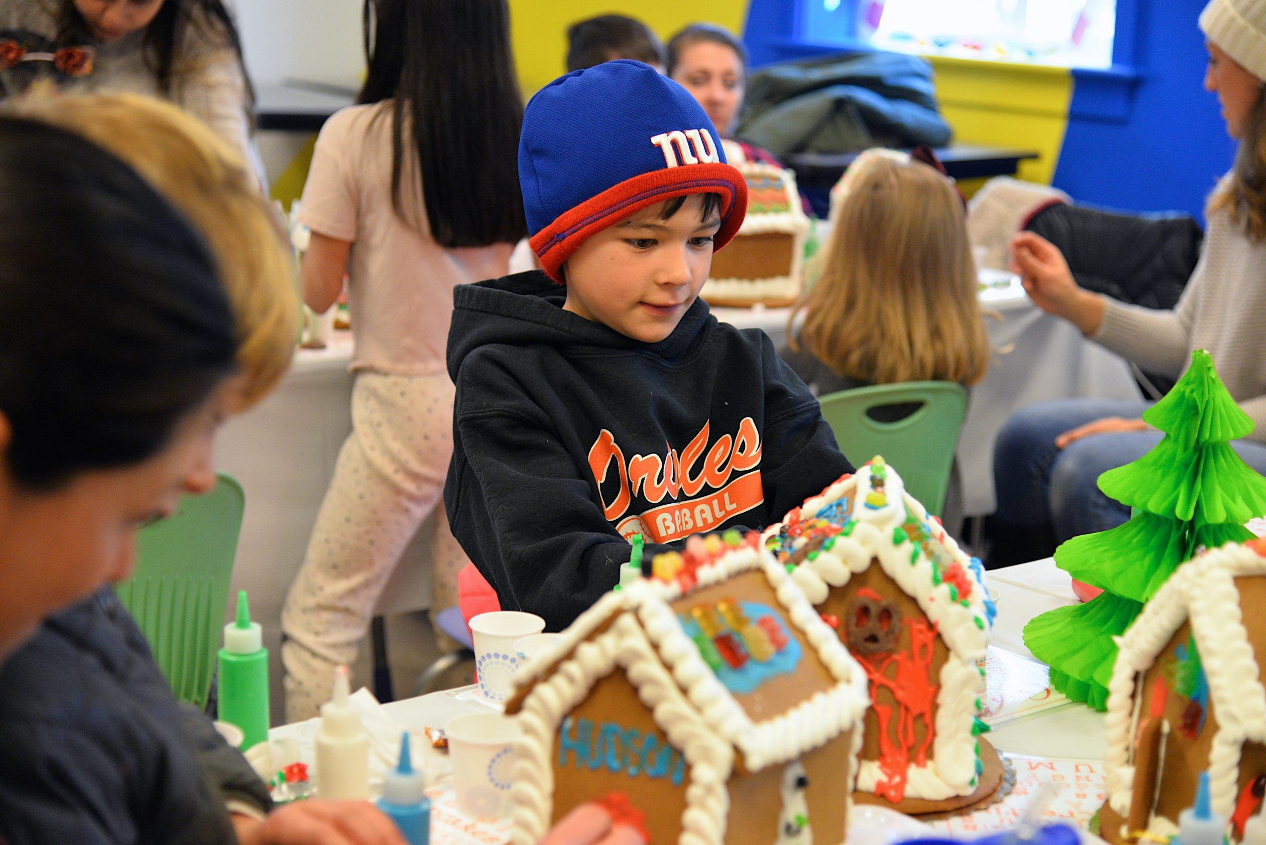 Guild Hall offered an opportunity to get in the holiday spirit by making gingerbread houses on Saturday. Harry Thomas working on his creation. KYRIL BROMLEY