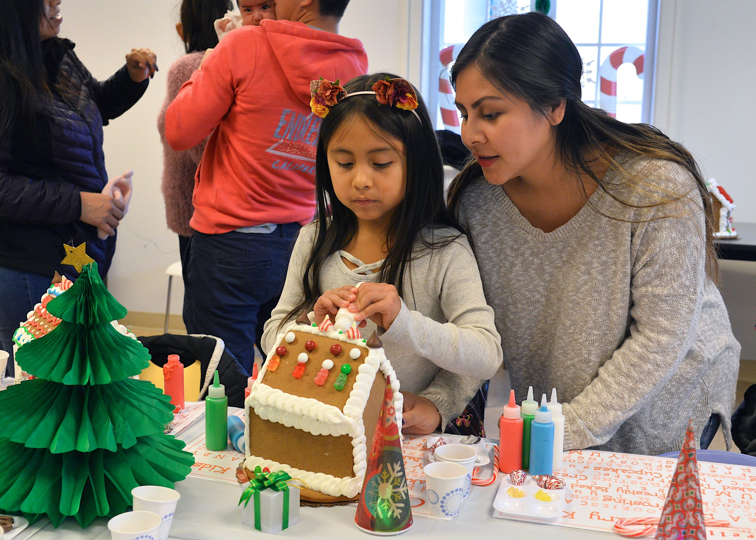 Guild Hall offered an opportunity to get in the holiday spirit by making gingerbread houses on Saturday. Sofia Calle and Andrea Vera working together.  KYRIL BROMLEY