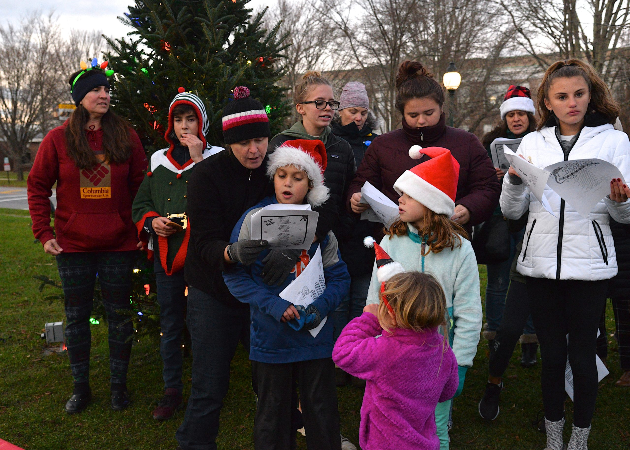 Members of the East Hampton Presbyterian Churc set out for a stroll on Sunday to sing Christmas carols in the village business district. KYRIL BROMLEY