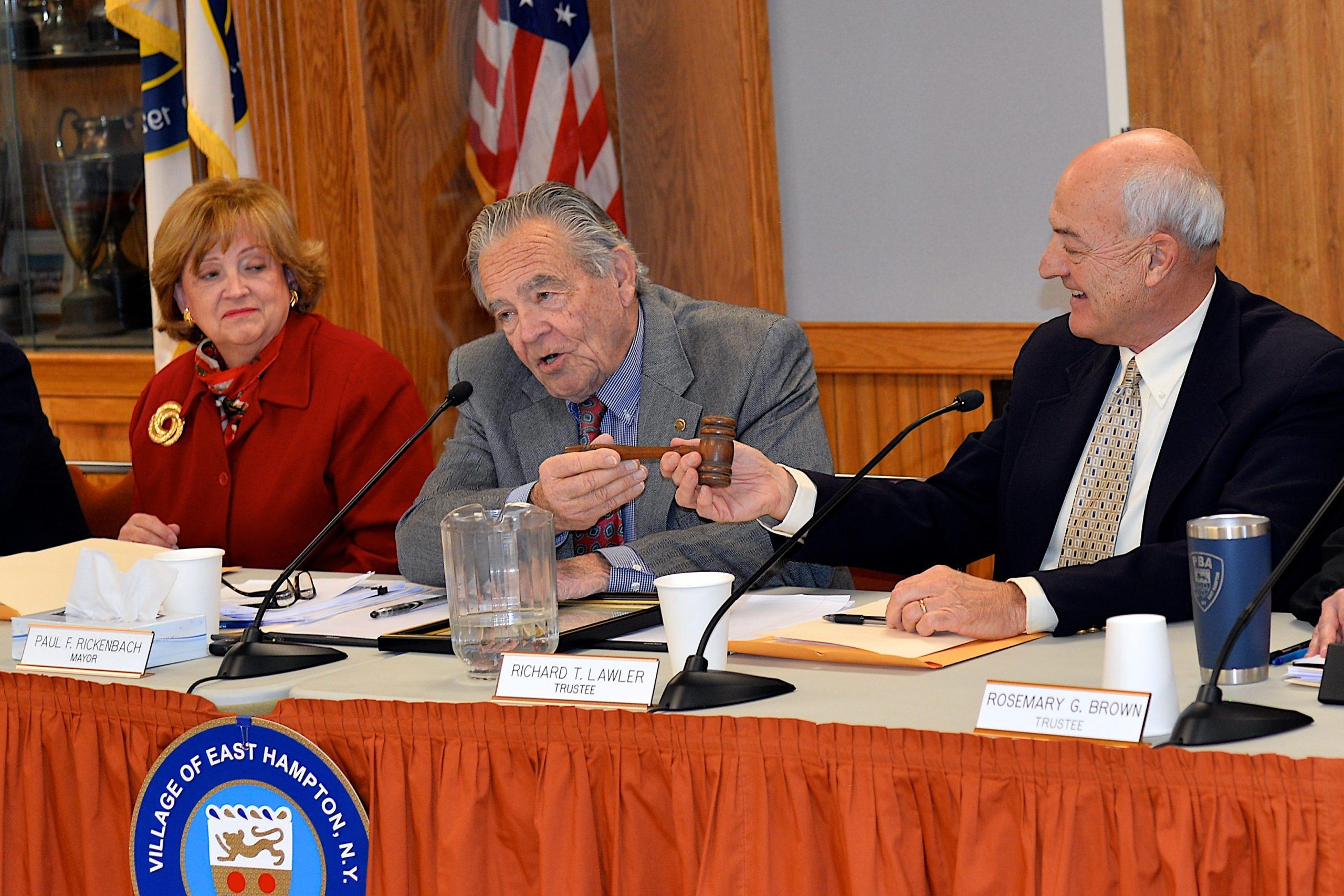 East Hampton Mayor Paul F. Rickenbach Jr. hands the gavel over to Deputy Mayor Richard Lawler. Barbara Borsack, left, is running for mayor in 2020.    KYRIL BROMLEY