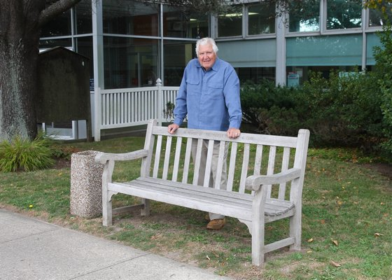 Phil DeFina at the Montauk post office bench that sparked his mission to clean more than 100 benches hamletwide. KYRIL BROMLEY