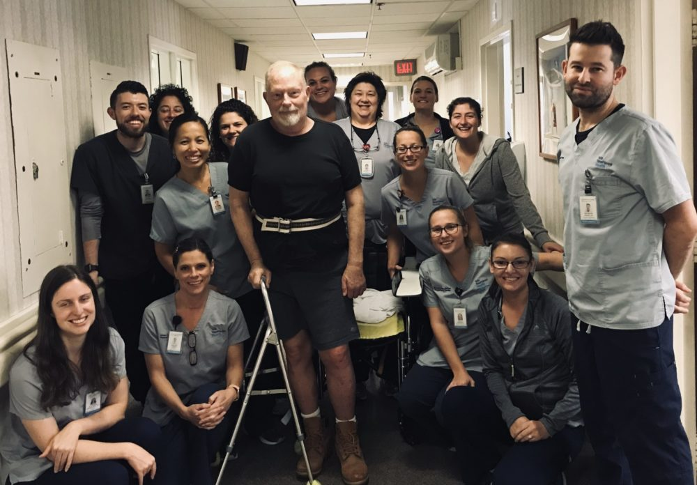 Michael Diusher surrounded by staff on the day of his release from the rehabilitation center.