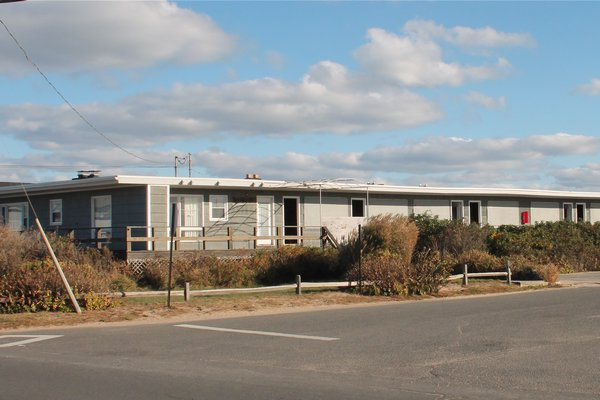 The East Deck Motel's owners have proposed tearing it down and building four homes on the Ditch Plains oceanfront.