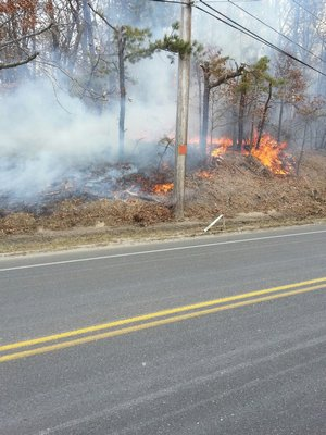 The brush fire at Old Country Road in Eastport on Wednesday. ROB DePIERRO