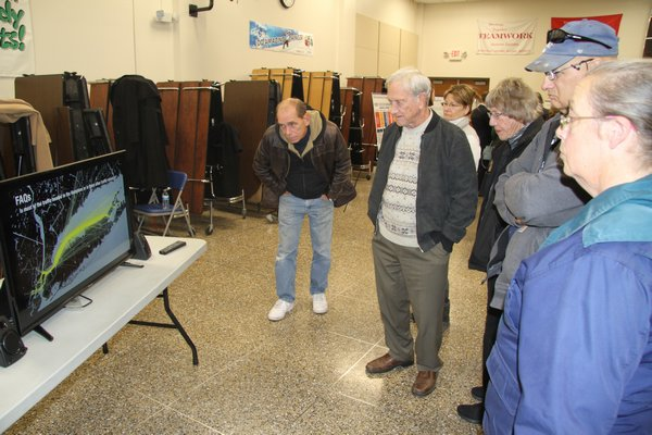 East End residents watched an FAA video explaining helicopter routes between New York City and East Hampton at Riverhead Middle School last week. Michael Wright