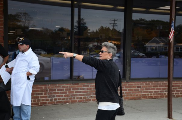 UFCW Local 342 Director Kelly Egan stands in front of the Westhampton Beach Waldbaums on Friday to get residents to sign a petition that she hopes will get a judge to reverse his decision on accepting Best Yet's highest bid to takeover the bankrupt supermarket. GREG WEHNER