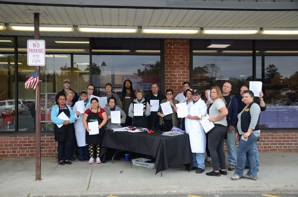 Employees of the Westhampton Beach Waldbaum's supermarket and members of UFCW Local 342 Union stand in front of the bankrupt supermarket