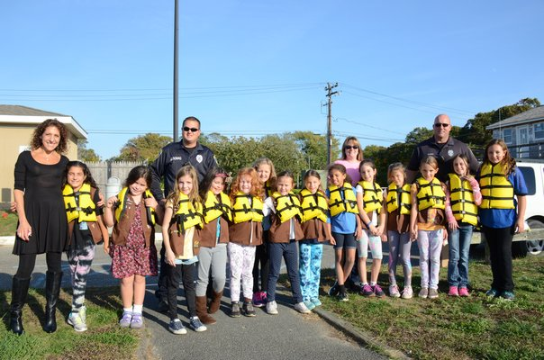 Two of the Town of Southampton's Bay Constables took time out of their day to work on  the 'Wonders of Water Badge' with Girl Scout Brownie Troop 759 from Quogue at the Meschutt marina on October 21