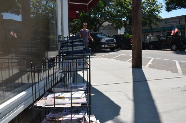 Free magazines line the streets in Southampton Village during the summer months. GREG WEHNER