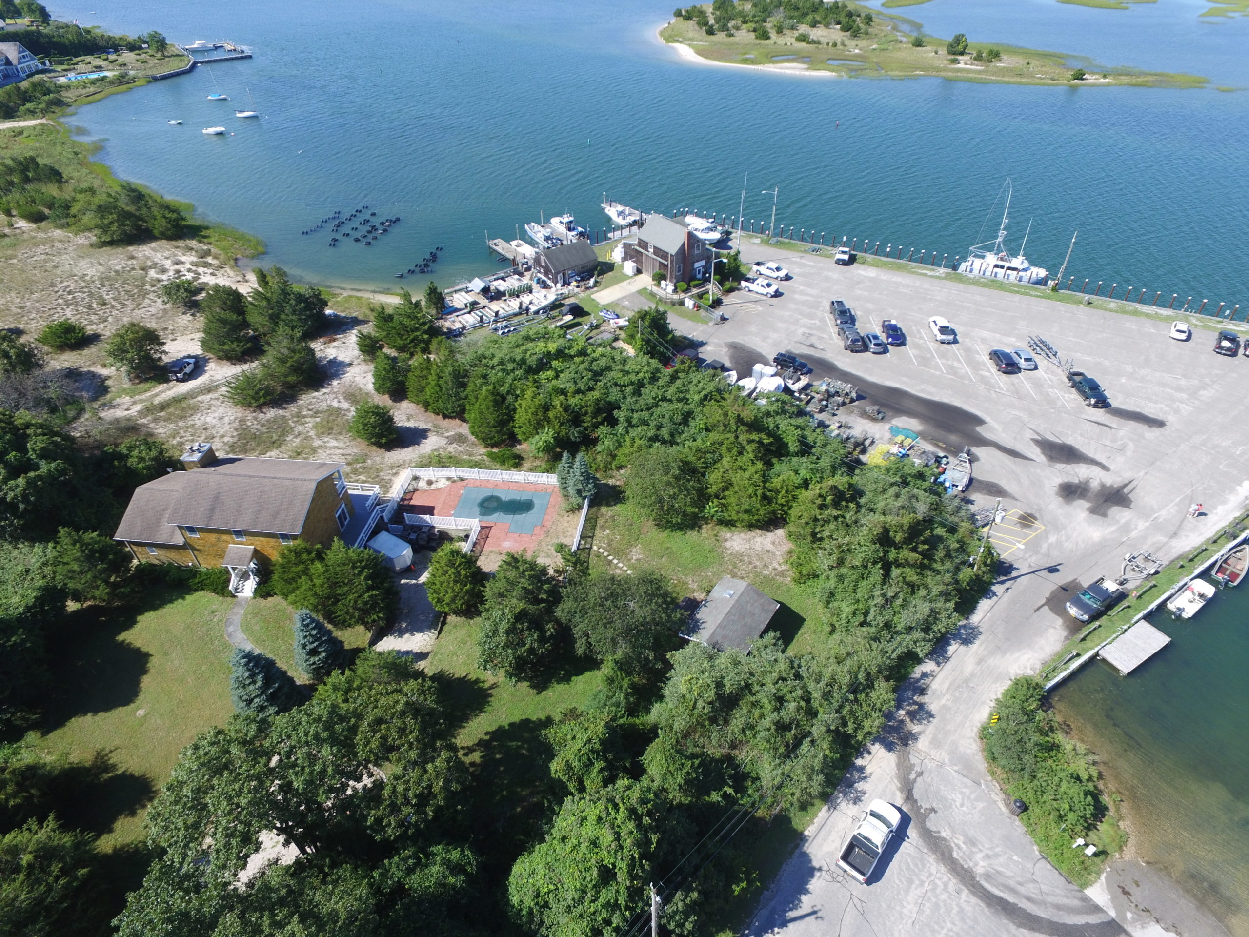 East Hampton Town will try again in 2020 for New York State grant funding to support its plans to build a new shellfish hatchery facility on Gann Road. The town purchase the house and land in the foreground in 2018 to use for the new hatchery facility.