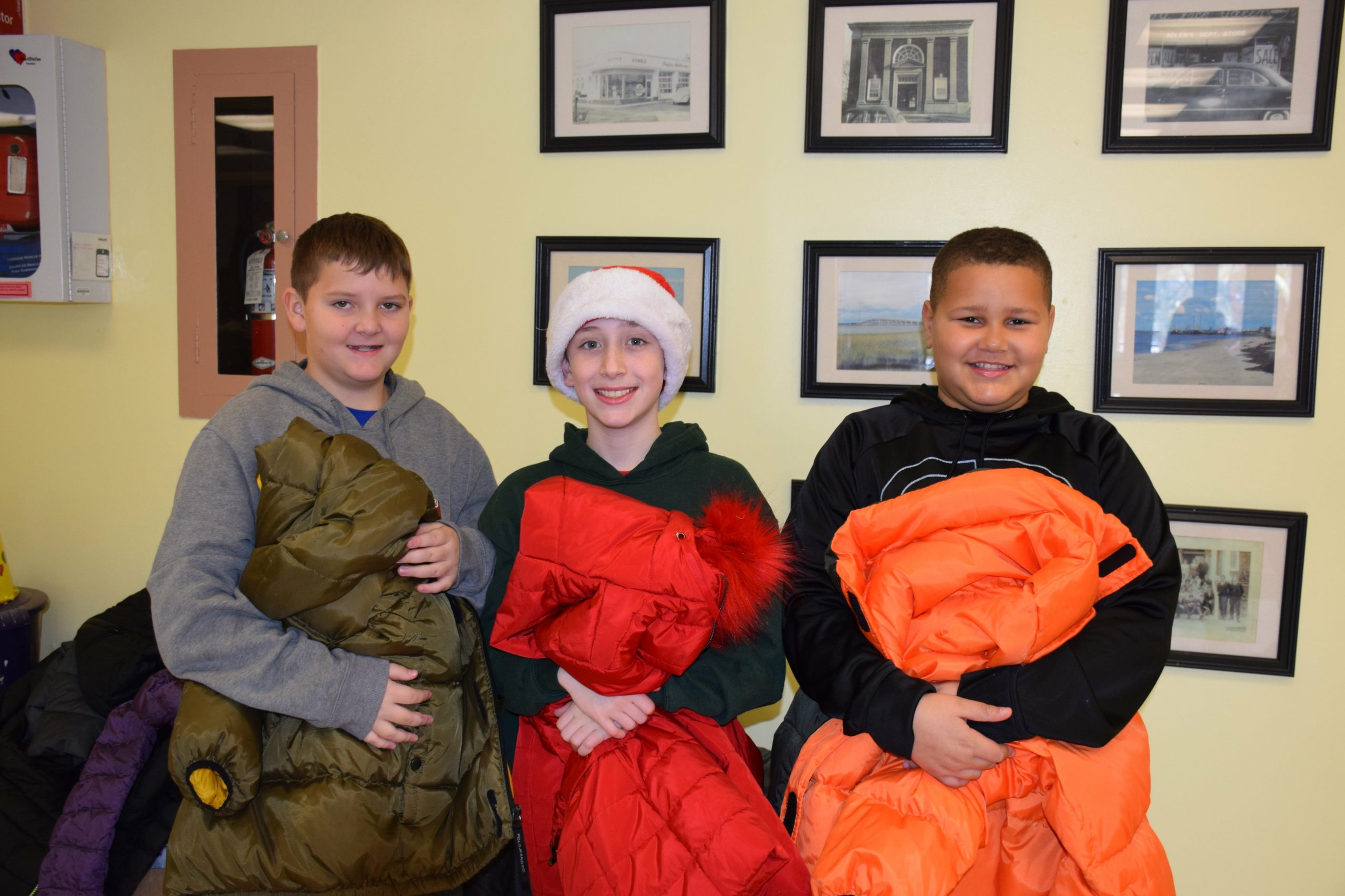 To give back to the community, members of the Hampton Bays Elementary School K-Kids community service club recently organized a coat drive. All coats will be donated to local families in need. From left,  K-Kids Liam Fitzgerald, Sean Donahue and John Hayes.