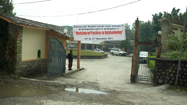 Entrance to the Himalayan Eye Hospital with the welcome banner.