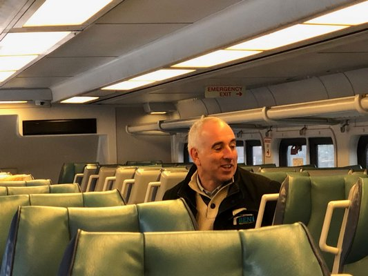 Southampton Town Supervisor Jay Schneiderman rides the South Fork Commuter Connection on Monday morning. JOE SHAW