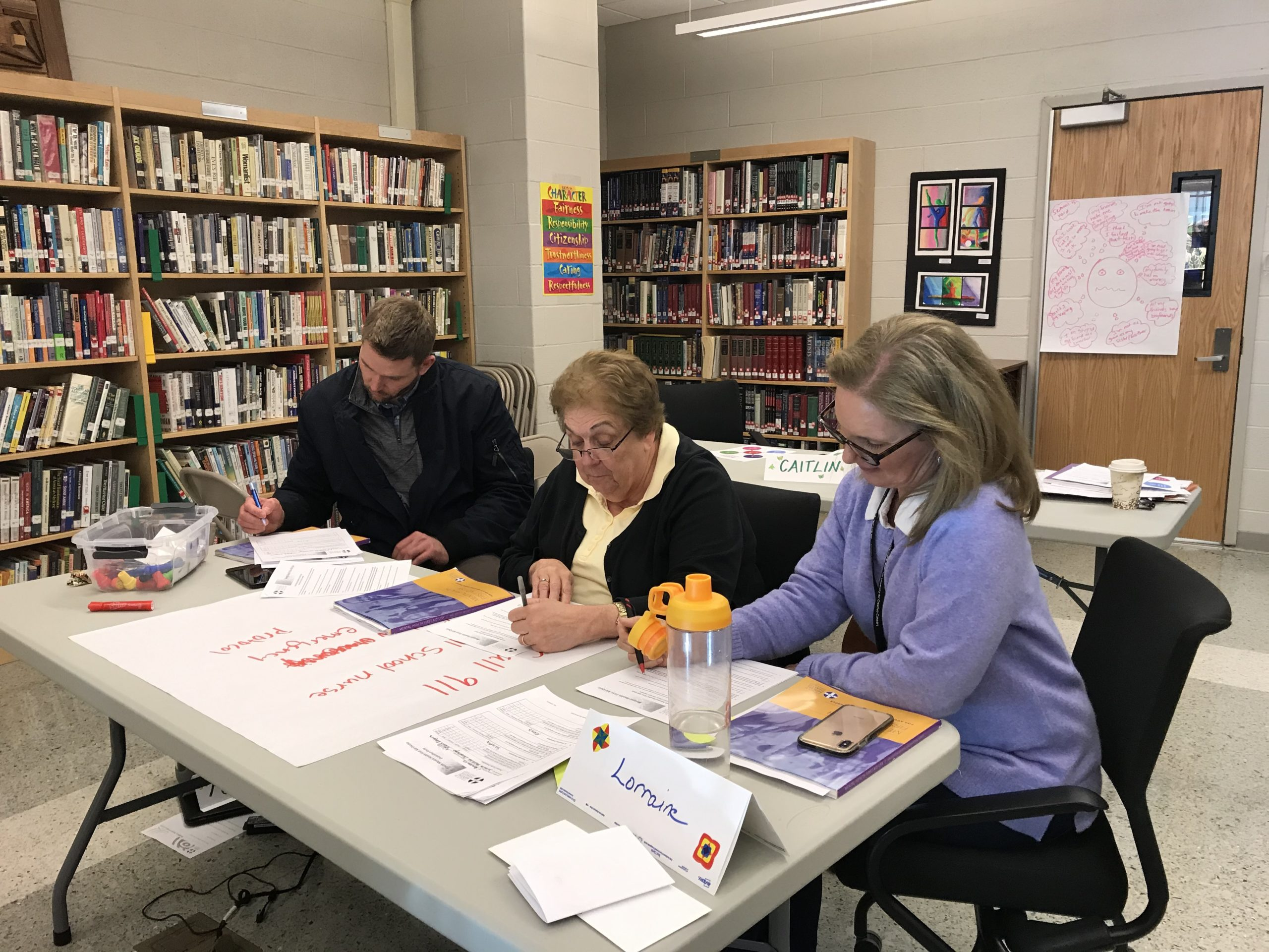 Psychologists, police officers, counselors, and staffers at East Hampton High School completed a Mental Health First Aid counseling program on Friday.  ELIZABETH VESPE