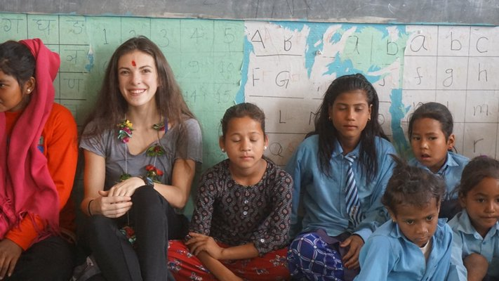 Rachel Osborne with some of the children in the village. COURTESY WILLIAM BARBOUR