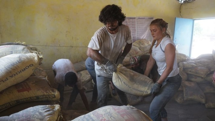 Vincenzo Salsedo and Sophia Swanson working to build the school in Nepal.  COURTESY WILLIAM BARBOUR