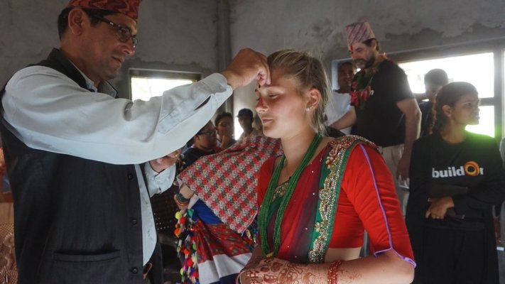 Sophia Swanson getting a tilaka placed on her head.  COURTESY WILLIAM BARBOUR
