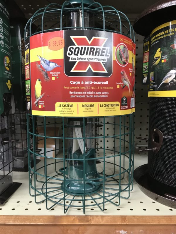 This bird seed feeder is simply a wire cage protecting the vertical seed tube in the center. It will keep the squirrels at bay, but it will also exclude larger birds like cardinals and jays.