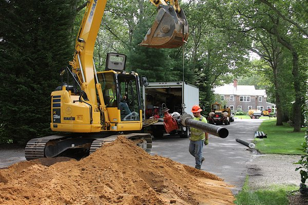 The Suffolk County Water Authority began installing new water supply mains to homes in southern Wainscott as part of an effort funded by East Hampton Town to alleviate concerns about chemically tainted groundwater supplies in the area. Kyril Bromley