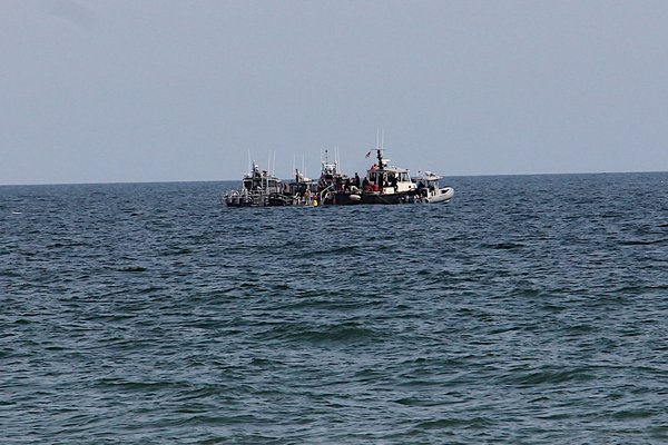 Patrol boats off Atlantic Avenue Beach on Friday.    KYRIL BROMLEY