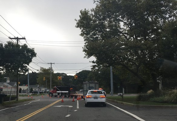Motorists driving south on Magee Street are unable to make a right onto County Road 39 due to the road closure Wednesday morning. Emergency personnell directed traffic east.