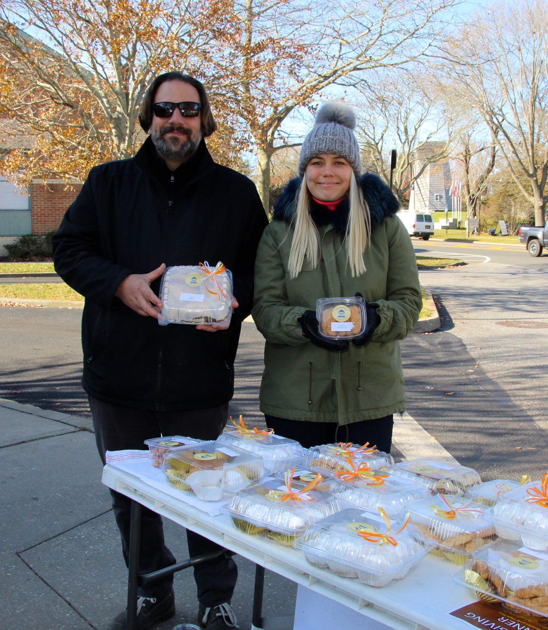 Greek pastries from the Greek Orthodox Church of the Hamptons were for sale outside the East Hampton post office on Saturday.  Father Constantine Lazarakis and Afrodite Stergiou manned the table. KYRIL BROMLEY