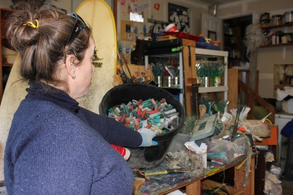 Carolyn Munaco sorts through the trash found on the beach. VALERIE GORDO