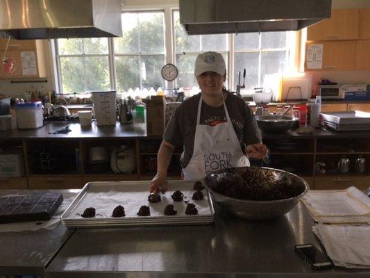 Sasha Garcia scoops chocoloate chunkie dough onto a baking tray. SHIRLEY RUCH