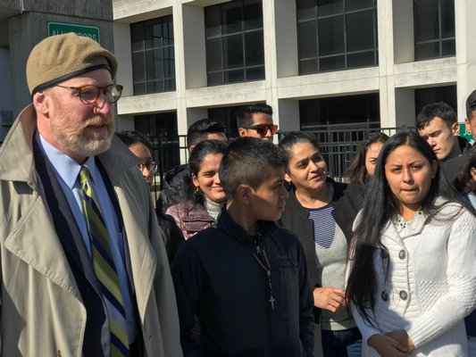 Attorney Daniel Rodgers with family and friends of Bryan Siranaula outside of Suffolk County Criminal Court in February.   PRESS FILE